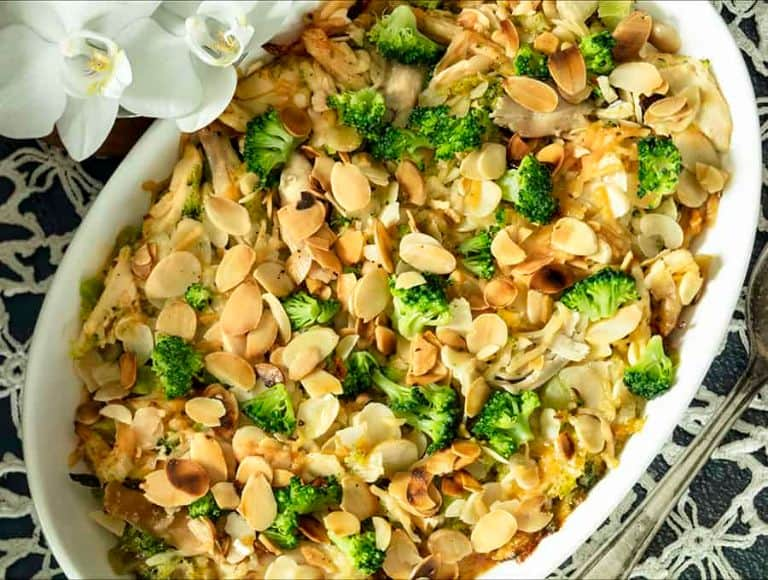 creamy broccoli chicken casserole in a white baking dish
