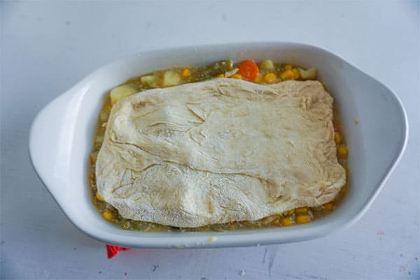 Homestyle Chicken Pot Pie in a white baking dish on a white table