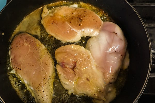 browning chicken breasts in a skillet