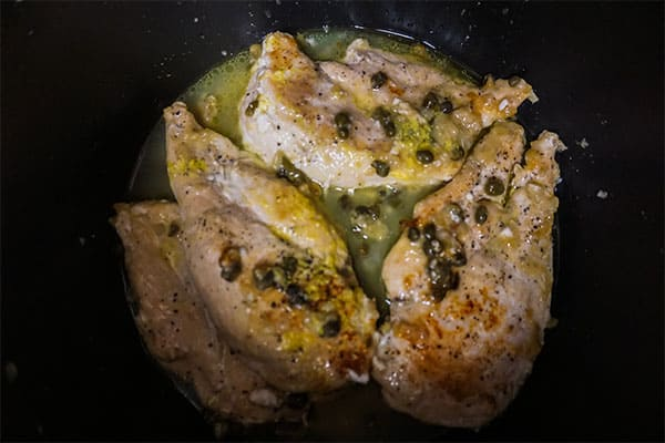 chicken piccata with capers and lemon juice in a slow cooker