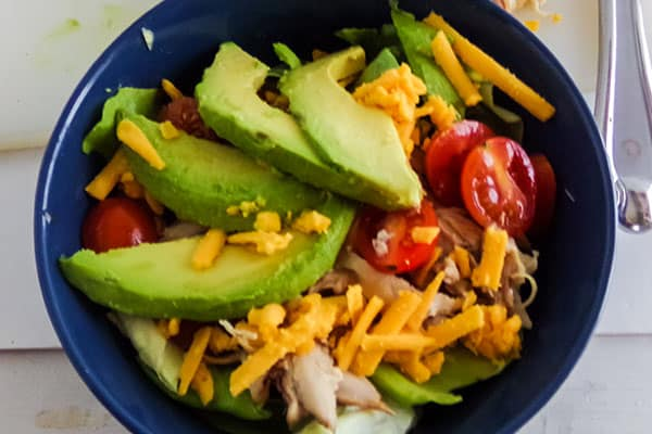 chicken taco salad in a blue bowl